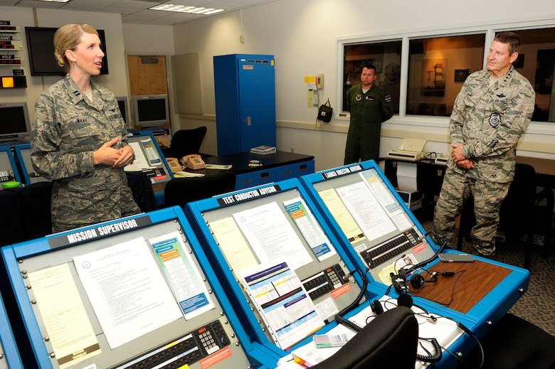 Gen. Robin Rand, commander of Air Force Global Strike Command, is briefed by Capt. Karrie Wray, 576th Flight Test Squadron ICBM test manager, during a tour of the 576th FLTS Aug. 18, 2015, Vandenberg Air Force Base, Calif. (U.S. Air Force photo by Staff Sgt. Jim Araos/Released)