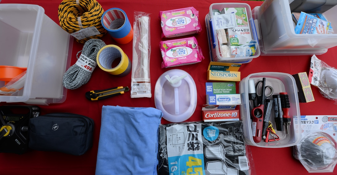 The contents of a typhoon kit are displayed on a table in front of the Exchange at the Typhoon Preparedness Extravaganza on Kadena Air Base, Japan, Aug. 15, 2015. The contents included the basic items to get through most natural disasters that may occur on Okinawa. The total amount spent to build a kit ranges from $70 to $150. (U.S. Air Force photo by Senior Airman Omari Bernard)