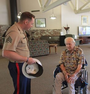 SACRAMENTO – A 100-year-old Marine, Michael Kolesar, meets with Sgt. Robert S. Powers, recruiter, Marine Recruiting Station Sacramento, at the Eskaton Care Center in Greenhaven, Aug. 21. Marines met with Michael to take photos as part of the care center's efforts to recognize centenarians. Michael fought during the famous battle of Guadalcanal. He later played professional baseball for the Browns and served as a deputy sheriff. (U.S. Marine Corps photo by Staff Sgt. Jacob Harrer / released)