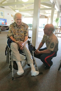 SACRAMENTO – A 100-year-old Marine, Michael Kolesar, meets Gunnery Sgt. Gerardo Ortiz, recruiting staff noncommissioned officer in charge, Marine Recruiting Station Sacramento, at the Eskaton Care Center in Greenhaven, Aug. 21. Marines met with Michael to take photos as part of the care center's efforts to recognize centenarians. Michael fought during the famous battle of Guadalcanal. He later played professional baseball for the Browns and served as a deputy sheriff. (U.S. Marine Corps photo by Staff Sgt. Jacob Harrer / released)