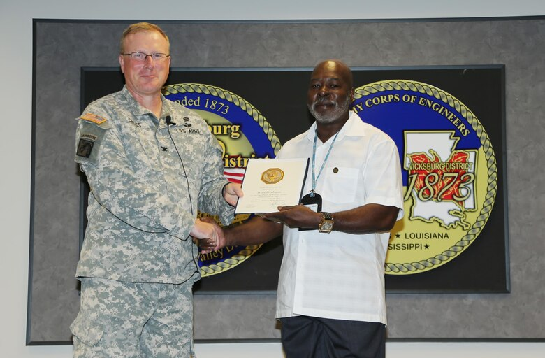 Wray Hogan received a certificate and pin for his 40 years of service in the Government of the United States of America. Hogan, also a Vietnam Era veteran, is a budget technician at the Louisiana Field Office.