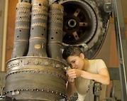 Airman 1st Class Rosemary Dimola, 361st Training Squadron student, installs and inspects thermocouples during a T-56 engine build up used on a C-130 Hercules aircraft Aug. 12, 2015, at Sheppard Air Force Base, Texas. The Thermocouples reads the inlet temperature inside the engine and is necessary for letting the pilot know the temperature of the turbine engine. (U.S. Air Force photo by Danny Webb)