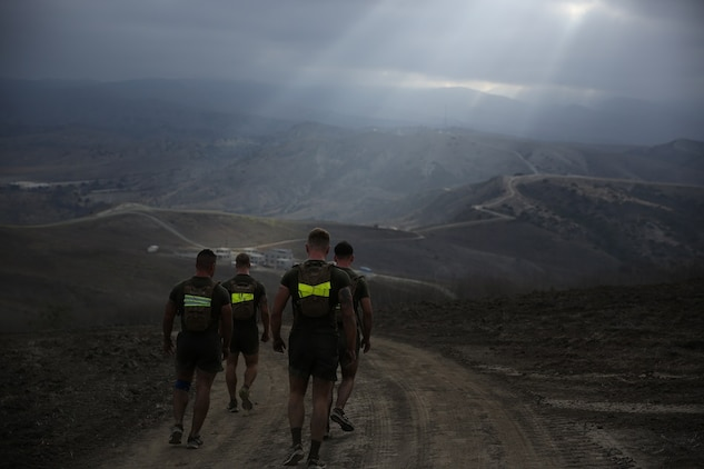 Marines assigned to Company K, 3rd Battalion, 5th Marine Regiment, 1st Marine Division, run along hills during the Dark Horse Ajax Challenge aboard Marine Corps Base Camp Pendleton, Calif., Aug. 20, 2015. The eight-mile course tested the Marines' and Sailors' endurance and leadership skills with trials spread across the San Mateo area. (U.S. Marine Corps photo by Cpl. Will Perkins)