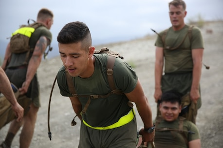 Marines assigned to Headquarters and Service Company, 3rd Battalion, 5th Marine Regiment, 1st Marine Division, carry a simulated casualty as part of the Dark Horse Ajax Challenge aboard Marine Corps Base Camp Pendleton, Calif., Aug. 20, 2015. The eight-mile course tested the Marines' and Sailors' endurance and leadership skills with trials spread across the San Mateo area. (U.S. Marine Corps photo by Cpl. Will Perkins)