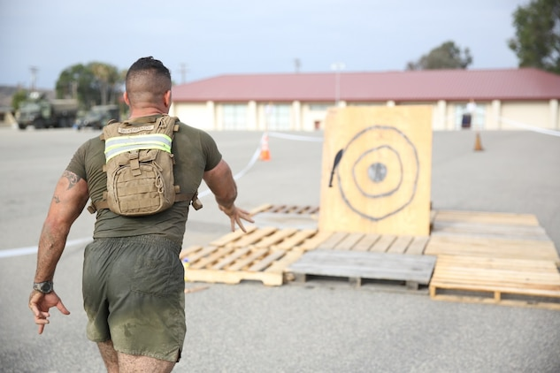 A Marine assigned to Company K, 3rd Battalion, 5th Marine Regiment, 1st Marine Division, throws a knife at a target as part of the Dark Horse Ajax Challenge aboard Marine Corps Base Camp Pendleton, Calif., Aug. 20, 2015. The eight-mile course tested the Marines' and Sailors' endurance and leadership skills with trials spread across the San Mateo area. (U.S. Marine Corps photo by Cpl. Will Perkins)