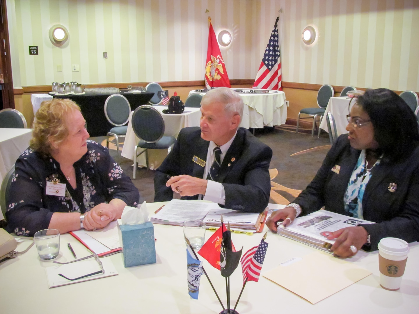 Mary McClung (left), meets with Defense Prisoner of War/Missing in Action Accounting Agency (DPAA) historian, Bill Woodier, and Marine Corps Service Casualty Officer Hatti Johnson, during the Korean/Cold War annual briefings Aug. 13-14, 2015, in Washington, D.C.  McClung spoke with officials regarding her father, Marine Corps Master Sgt. William J. McClung III, who was also a World War II veteran. Government officials from DPAA met with more than 300 family members of servicemen who went missing during past conflicts. Representatives from the U.S. government's personnel accounting community provided one-on-one case-specific, detailed information to family members and briefed them on the government's efforts to account for their loved ones, including briefings on government policy, remains recovery operations and methods of identifying remains.