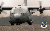 MALEMUTE DROP ZONE, Alaska -- A C-130 of the Alaska Air National Guard's 144th Airlift Squadron practices touch-and-go landings here Aug. 16, 2015. National Guard photo by Capt. John Callahan.