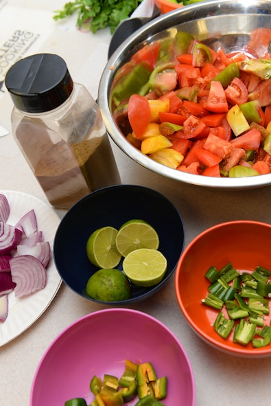 Ingredients are prepped during the EMFP Garden to Table Cooking Class, August 6, 2015, Scott Air Force Base, Illinois. Operation Food Search taught the class, which was focused on using fresh produce and incorporating it into meals, using the examples of quesadillas, salsa and a cantaloupe salad. (U.S. Air Force photo by Airman 1st Class Erica Holbert-Siebert)