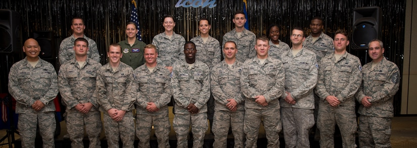 Col. Jimmy Canlas, 437th Airlift Wing vice commander (left) and Chief Master Sgt. Kristopher Berg, 437th AW command chief (right), stand with Staff Sgt. selects from the 437th AW Aug. 20, 2015, at the Charleston Club on Joint Base Charleston, S.C. The purpose of the event was to highlight the achievement, acknowledge the selectees and give them an opportunity to celebrate and socialize with other selectees, friends and family. (U.S. Air Force photo/Airman 1st Class Clayton Cupit)