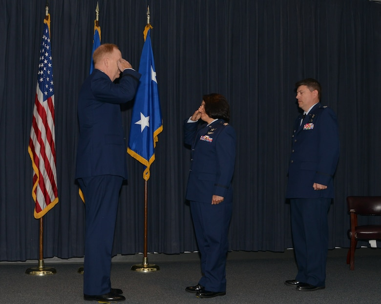Col. Shahnaz Punjani, incoming director of the Operationally Responsive Space Office salutes presiding officer Maj. Gen. Robert McMurry, Space and Missile Systems Center vice commander during a change of command ceremony at Kirtland Air Force Base, N.M. Aug. 17. Looking on is Col. John Anttonen outgoing ORS director who moves over to be director of the Advanced Systems and Development Directorate and commander of SMC's Detachment 1 at Kirtland in an assumption of command ceremony held later in the day (U.S. Air Force courtesy photo)