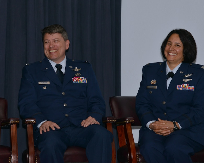 Col. John S.R. Anttonen, outgoing Operationally Responsive Space Office director and Col. Shahnaz Punjani, incoming director of ORS share a light moment during the change of command ceremony at Kirtland Air Force Base, N.M. Aug. 17. Anttonen moves over to be director of the Advanced Systems and Development Directorate and commander of Space and Missile Systems Center's Detachment 1 at Kirtland during an assumption of command ceremony held later in the day (U.S. Air Force courtesy photo)