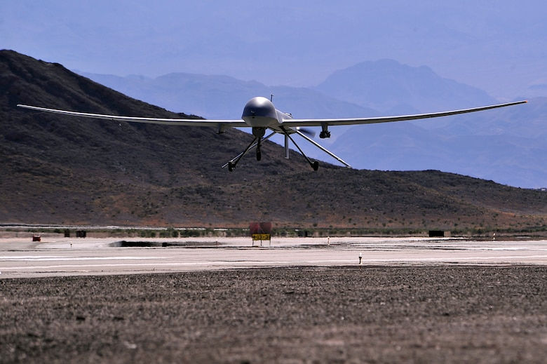 An MQ-1B Predator remotely piloted aircraft comes in for a 'touch-and-go' during a training mission, May 13, 2013. The MQ-1B Predator is an armed, multi-mission, medium-altitude, long-endurance remotely piloted aircraft that is employed primarily as an intelligence-collection asset and secondarily for munitions capability to support ground troops and base defense. (U.S. Air Force photo by 432nd Wing/432nd Air Expeditionary Wing/Released)