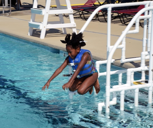 A child plays in Marine Corps Logistics Base Albany's pool as part of the 2015 Summer Reading Program awards ceremony, Aug. 22. The ceremony was held at the installation's Town and Country Restaurant Grand Ballroom. Top readers in four different age groups received trophies and all of the participants received certificates as their parents watched or photographed them.