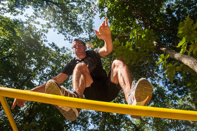 "Tech. Sgt. Justin B. Gielski balances on a set of bars he built in the backyard of his home in Medford, N.J.,  as he trains to compete on the TV show ""American Ninja Warrior"" Aug. 21, 2015. Gielski placed fifth in the all-military city final on the TV show and advanced to the finals in Las Vegas. Gielski is a loadmaster with the 150th Special Operations Squadron, 108th Wing, New Jersey Air National Guard, located at Joint Base McGuire-Dix-Lakehurst, N.J. (U.S. Air National Guard photo by Master Sgt. Mark C. Olsen/Released)"