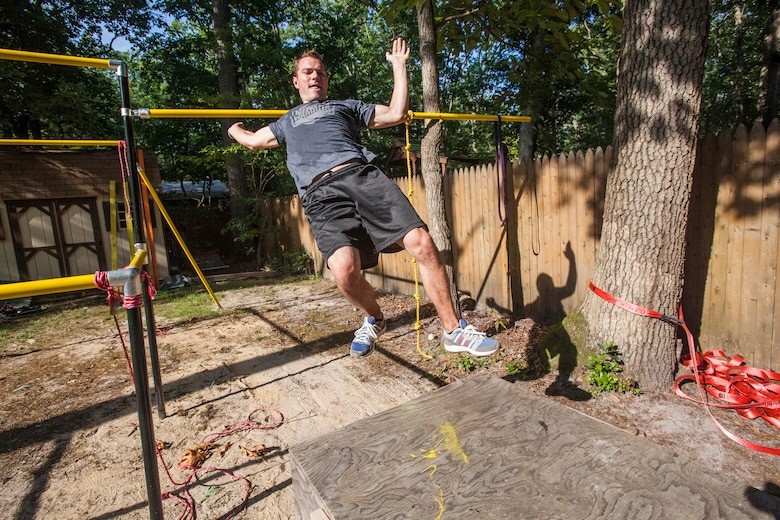 "Tech. Sgt. Justin B. Gielski trains to compete on the TV show ""American Ninja Warrior"" in the backyard of his home in Medford, N.J., Aug. 21, 2015. Gielski placed fifth in the all-military city final on the TV show and advanced to the finals in Las Vegas. Gielski is a loadmaster with the 150th Special Operations Squadron, 108th Wing, New Jersey Air National Guard, located at Joint Base McGuire-Dix-Lakehurst, N.J. (U.S. Air National Guard photo by Master Sgt. Mark C. Olsen/Released)"