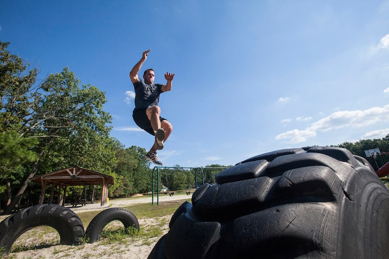 "Tech. Sgt. Justin B. Gielski jumps from one tire to another while training to compete on the TV show ""American Ninja Warrior"" at a playground near his home in Medford, N.J., Aug. 21, 2015. Gielski placed fifth in the all-military city final on the TV show and advanced to the finals in Las Vegas. Gielski is a loadmaster with the 150th Special Operations Squadron, 108th Wing, New Jersey Air National Guard, located at Joint Base McGuire-Dix-Lakehurst, N.J. (U.S. Air National Guard photo by Master Sgt. Mark C. Olsen/Released)"