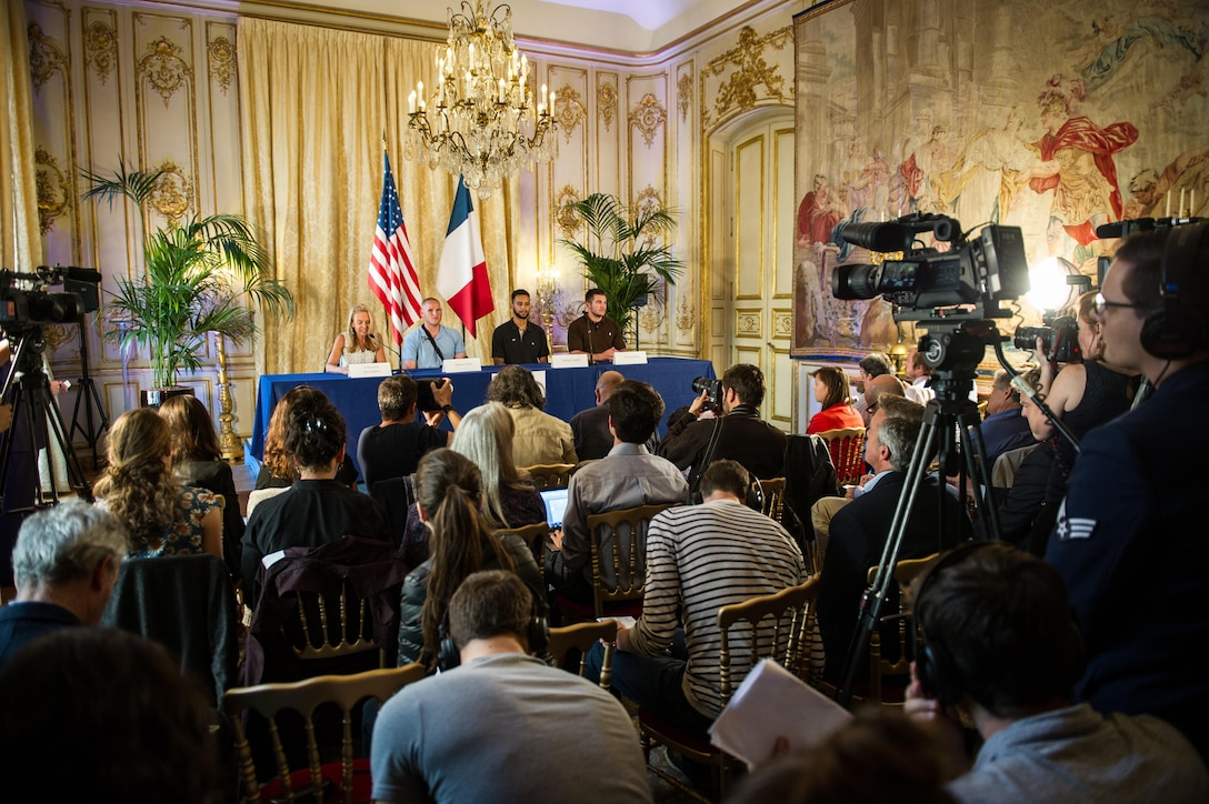 Airman 1st Class Spencer Stone along with Jane D. Hartly,  the U.S. ambassador to France, and his two friends speak at a press conference in Paris Aug. 23, 2015, following a foiled attack on a French train. Stone was on vacation with his childhood friends, Aleksander Skarlatos and Anthony Sadler, when an armed gunman entered their train carrying an assault rifle, a handgun and a box cutter. The three friends, with the help of a British passenger, subdued the gunman after his rifle jammed. Stone's medical background prepared him to begin treating wounded passengers while waiting for the authorities to arrive. Stone is an ambulance service technician assigned to the 65th Medical Operations Squadron stationed at Lajes Field, Azores. (U.S. Air Force photo/Tech. Sgt. Ryan Crane)