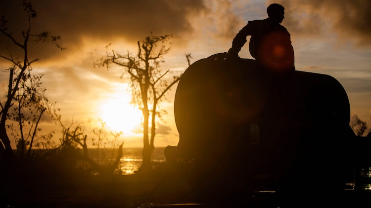 U.S. Marine Lance Cpl. Riley Remoket, with Combat Logistics Battalion 31, 31st Marine Expeditionary Unit, fills a water bull at a water distribution site during typhoon relief efforts in Saipan, Aug. 19, 2015. The Marines with Echo Company, Battalion Landing Team 2nd Battalion, 5th Marines, 31st MEU and CLB 31, 31st MEU, assisted the locals of Saipan by producing and distributing potable water. The Marines and sailors of the 31st MEU were conducting training near the Mariana Islands when they were redirected to Saipan after the island was struck by Typhoon Soudelor Aug. 2-3.