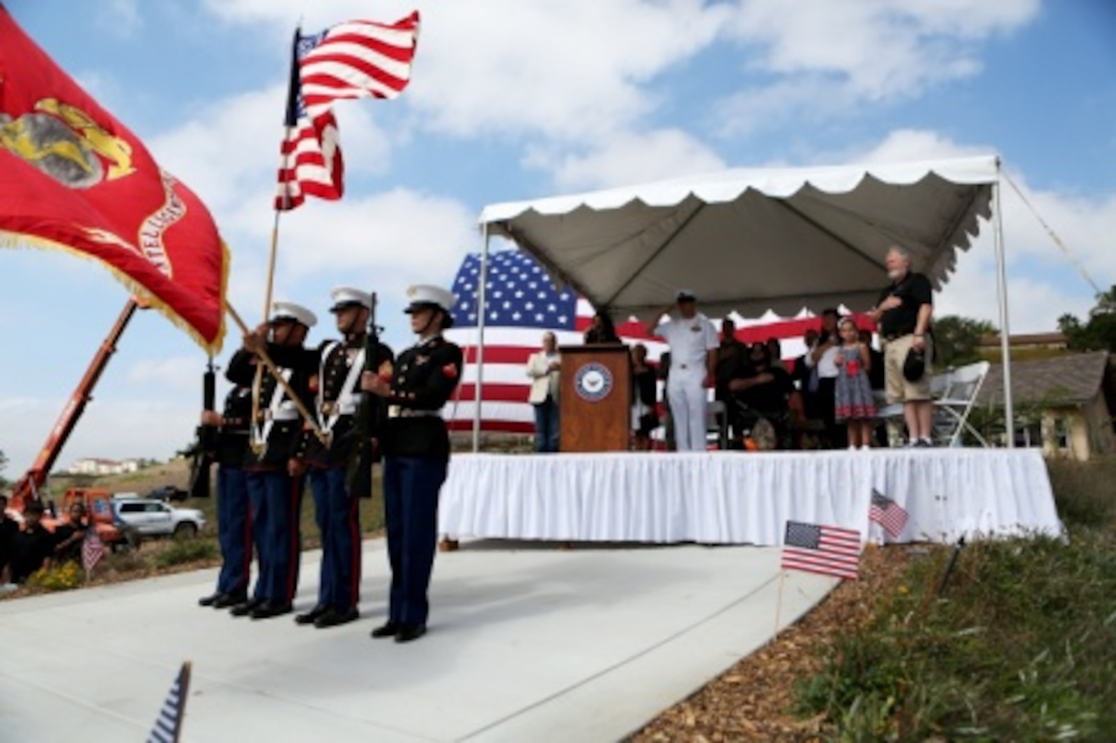 Marines from 1st Intelligence Battalion, 1st Marine Logistics Group present the national and Marine Corps colors during a ceremony where The Gary Sinise Foundation presented and newly built Smart home to retired Staff Sgt. Jason Ross and his family. Ross stepped was injured by an improvised explosive device in Afghanistan in 2011 while serving as an explosive ordnance disposal technician and lost both of his legs as a result. The new home has smart technology that will significantly reduce the difficulty of everyday tasks for Ross and allow him and his family to live more comfortably.