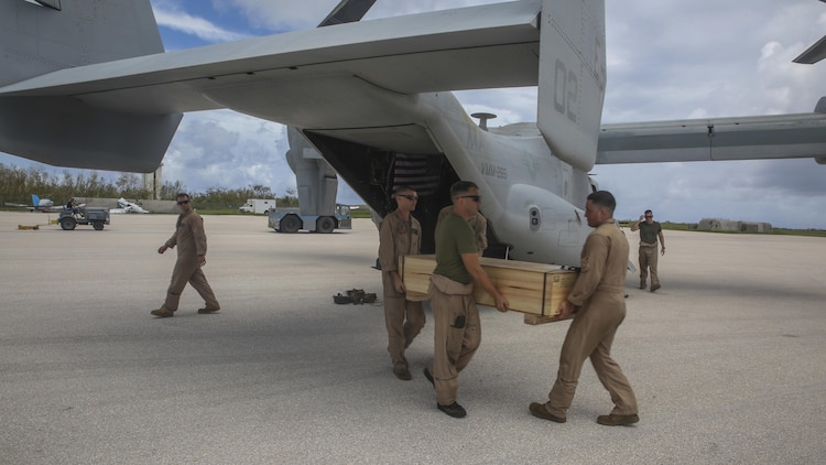 U.S. Marines unload gear from a MV-22B Osprey assigned to Marine Medium Tiltrotor Squadron 265 (Reinforced), 31st Marine Expeditionary Unit, as a part of a typhoon relief mission in Saipan, Aug. 12, 2015. The Marines of VMM-265 (Rein.), 31st MEU, flew emergency relief supplies into Saipan to assist with typhoon relief efforts. The Marines and sailors of the 31st MEU were conducting training near the Mariana Islands when they were redirected to Saipan after the island was struck by Typhoon Soudelor Aug. 2-3.
