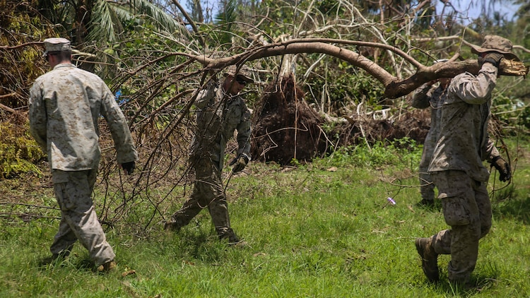 U.S. Marines clear debris at a high school as part of a typhoon relief mission in Saipan Aug. 12, 2015 The Marines with Echo Company, Battalion Landing Team 2nd Battalion, 5th Marines, 31st Marine Expeditionary Unit and Combat Logistics Battalion 31, 31st MEU, assisted the locals of Saipan by clearing debris from several schools. The Marines and sailors of the 31st MEU were conducting training near the Mariana Islands when they were redirected to Saipan after the island was struck by Typhoon Soudelor Aug. 2-3.