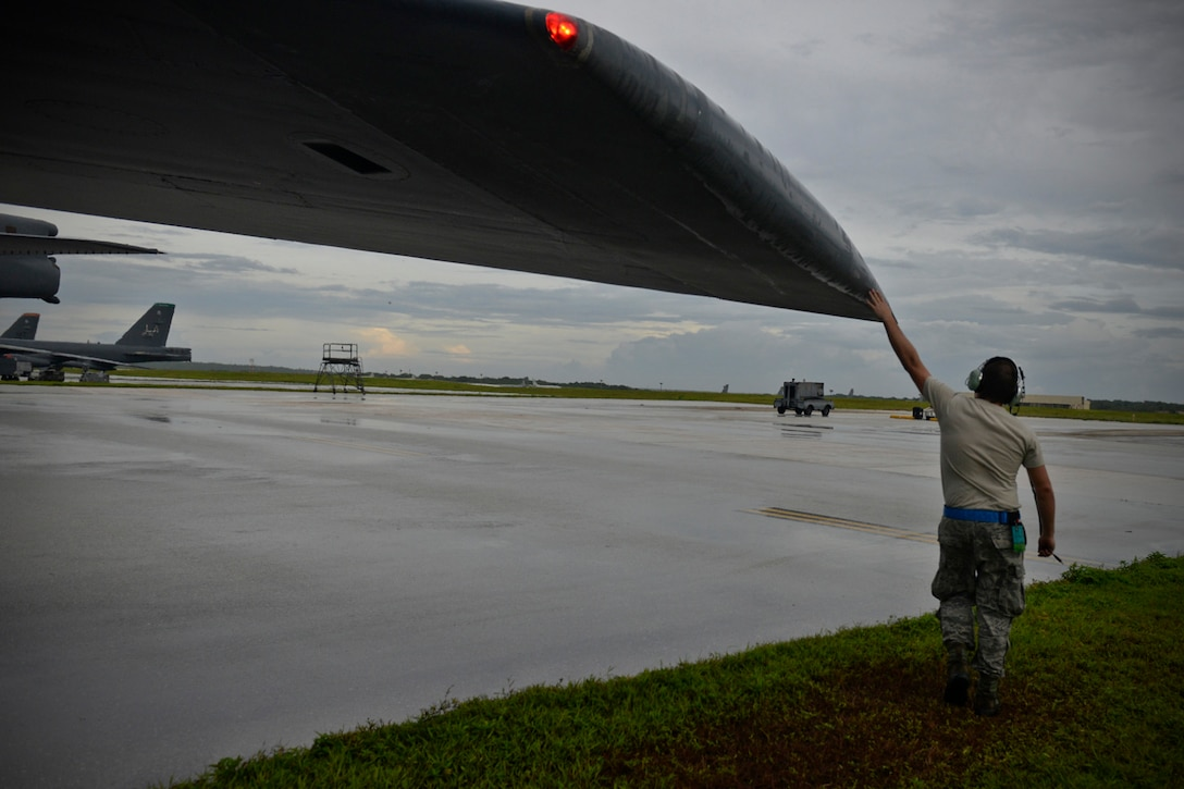 Staff Sgt. Stephen Cole, a U.S. Air Force B-52 Stratofortress crew chief assigned to the 20th Expeditionary Aircraft Maintenance Squadron, gives his aircraft a final good-luck touch before takeoff Aug. 22, 2015, at Andersen Air Force Base, Guam. Bomber crews with the 20th Expeditionary Bomb Squadron from Barksdale Air Force Base, Louisiana, are part of U.S. Pacific Command's continuous bomber presence and support ongoing operations in the Indo-Asia-Pacific region. (U.S. Air Force photo by Staff Sgt. Alexander W. Riedel/Released)