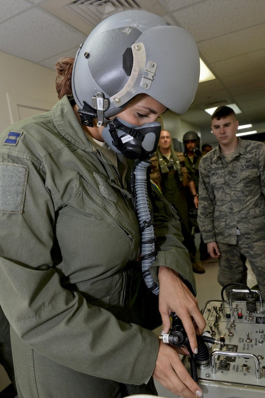 Capt. Marisa Whitaker, U.S. Air Force B-52 Stratofortress aircraft commander, 20th Expeditionary Bomb Squadron from Barksdale Air Force Base, Louisiana, performs preflight checks on her oxygen mask to ensure it is not leaking and the valves are working properly Aug. 22, 2015, at Andersen Air Force Base, Guam.  Whitaker is part of an aircrew that was called upon to support ongoing operations in the Indo-Asia-Pacific region. (U.S. Air Force photo by Staff Sgt. Robert Hicks/Released)