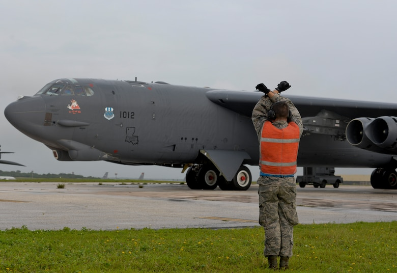 An Airman from the 20th Expeditionary Aircraft Maintenance Squadron prepares to taxi a U.S. Air Force B-52 Stratofortress Aug. 22, 2015, at Andersen Air Force Base, Guam. Bomber crews with the 20th EBS from Barksdale Air Force Base, Louisiana, are part of U.S. Pacific Command's Continuous Bomber Presence and support ongoing operations in the Indo-Asia-Pacific region. (U.S. Air Force photo by Staff Sgt. Robert Hicks/Released)
