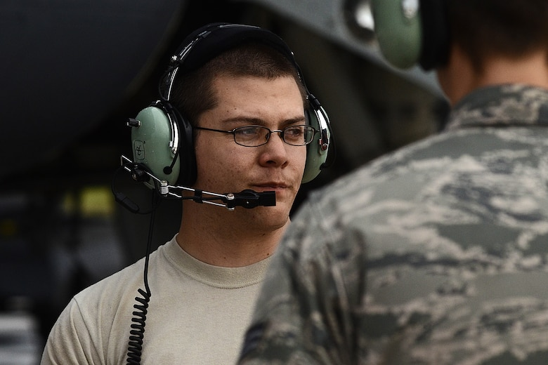 Staff Sgt. Stephen Cole, a U.S. Air Force B-52 Stratofortress crew chief assigned to the 20th Expeditionary Aircraft Maintenance Squadron, talks to his wingmen during preflight operations Aug. 22, 2015, at Andersen Air Force Base, Guam.  Bomber crews with the 20th Expeditionary Bomb Squadron from Barksdale Air Force Base, Louisiana, are part of U.S. Pacific Command's continuous bomber presence and support ongoing operations in the Indo-Asia-Pacific region. (U.S. Air Force photo by Staff Sgt. Alexander W. Riedel/Released)