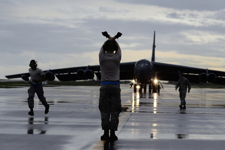 A U.S. Air Force B-52 Stratofortress crew chief assigned to the 20th Expeditionary Aircraft Maintenance Squadron from Barksdale Air Force Base, Louisiana, marshals his aircraft on the flightline Aug. 22, 2015, at Andersen Air Force Base, Guam. Bomber crews with the 20th EBS are part of U.S. Pacific Command's continuous bomber presence and support ongoing operations in the Indo-Asia-Pacific region. (U.S. Air Force photo by Staff Sgt. Alexander W. Riedel/Released)