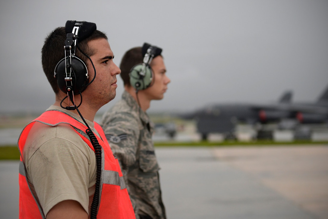 Senior Airmen Taylor Giordano, left, and Logan Turner, U.S. Air Force B-52 Stratofortress crew chiefs assigned to the 20th Expeditionary Aircraft Maintenance Squadron observe their aircraft during preflight checks Aug. 22, 2015, at Andersen Air Force Base, Guam. Bomber crews with the 20th Expeditionary Bomb Squadron from Barksdale Air Force Base, Louisiana, are part of U.S. Pacific Command's continuous bomber presence and support ongoing operations in the Indo-Asia-Pacific region. (U.S. Air Force photo by Staff Sgt. Alexander W. Riedel/Released)