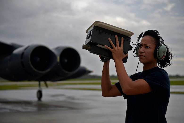 Senior Airman Alexandra Washington, communications and navigations technician assigned to the 20th Expeditionary Aircraft Maintenance Squadron, checks antennae signals on a B-52 Stratofortress before flight Aug. 22, 2015, at Andersen Air Force Base, Guam. Bomber crews with the 20th Expeditionary Bomb Squadron from Barksdale Air Force Base, Louisiana, are part of U.S. Pacific Command's continuous bomber presence and support ongoing operations in the Indo-Asia-Pacific region. (U.S. Air Force photo by Staff Sgt. Alexander W. Riedel/Released)