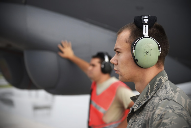 U.S. Air Force Senior Airmen Logan Turner, right, and Taylor Giordano, B-52 Stratofortress crew chiefs assigned to the 20th Expeditionary Aircraft Maintenance Squadron from Barksdale Air Force Base, Louisiana, observe their aircraft during launch operations Aug. 22, 2015, at Andersen Air Force Base, Guam. Bomber crews with the 20th Expeditionary Bomb Squadron are part of U.S. Pacific Command's continuous bomber presence and support ongoing operations in the Indo-Asia-Pacific region. (U.S. Air Force photo by Staff Sgt. Alexander W. Riedel/Released)