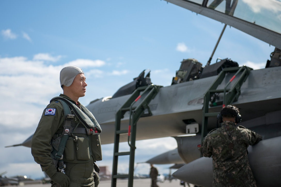 Republic of Korea Air Force (ROKAF) Maj. Lee Dong Seop, a ROKAF F-16D Fighting Falcon pilot, gathers his focus in front of his aircraft, Aug. 11, 2015, prior to the launch of a RED FLAG-Alaska (RF-A) 15-3 sortie from Eielson Air Force Base, Alaska. The ROKAF flew a squadron of F-16Ds across the Pacific Ocean to train in the Joint Pacific Alaska Range Complex's 67,000 square miles of airspace for two weeks of realistic combat flying training throughout RF-A 15-3. (U.S. Air Force photo by 1st Lt. Elias Zani/Released)