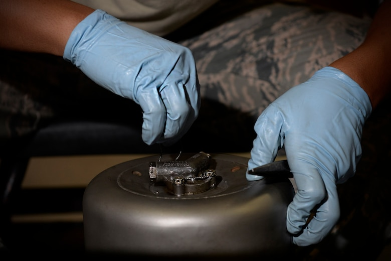 Airman 1st Class Michael Tallada, aerospace ground equipment apprentice and Guam native assigned to the 36th Maintenance Squadron, threads safety wire on a diesel generator exhaust part Aug. 12, 2015, at Andersen Air Force Base, Guam. The AGE maintainers care for a variety of essential equipment used during aircraft maintenance and preflight operations. (U.S. Air Force photo by Staff Sgt. Alexander W. Riedel/Released)