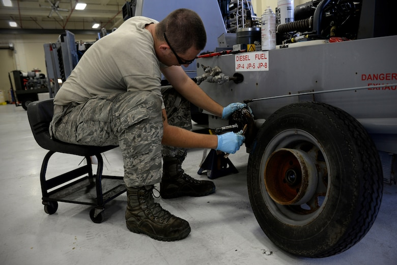 Senior Airman David Rippberger, aerospace ground equipment journeyman and deployed member of the 36th Maintenance Squadron, cleans brake pads on a towable air compressor Aug. 12, 2015, at Andersen Air Force Base, Guam. The maintainers regularly test brake parts for corrosion to ensure safety. (U.S. Air Force photo by Staff Sgt. Alexander W. Riedel/Released)