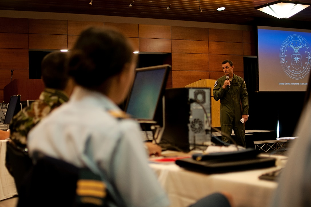 Lt. Col. Tom Bolin, commander of the Alaska Air National Guard's 176th Wing Operations Group, gives an opening speech at the beginning of the Pacific Airlift Rally on Joint Base Elmendorf-Richardson, Aug. 25. The Pacific Airlift Rally is a bi-annual, multinational military-airlift symposium for nations in the Indo-Pacific Region and is hosted by the Pacific Air Forces. (U.S. Air National Guard photo by Tech. Sgt. Alicia Halla)