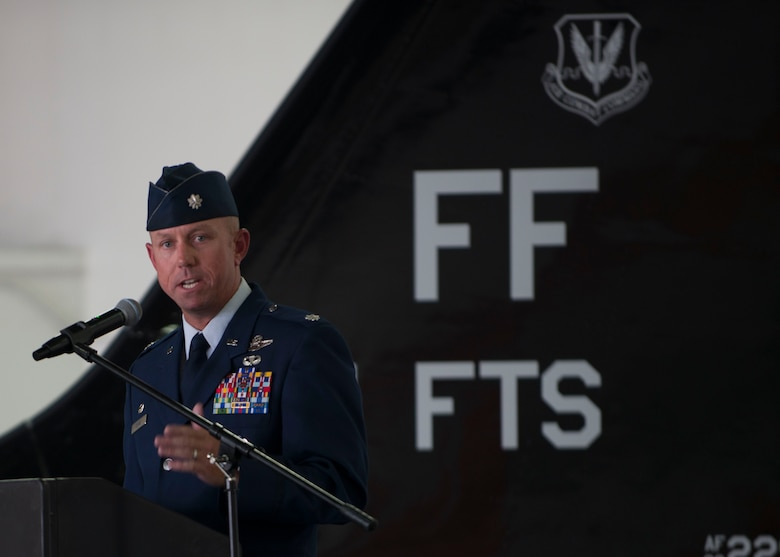 U.S. Air Force Lt. Col. Brian Coyne, 71st Fighter Training Squadron commander, speaks during the unit's reactivation ceremony at Langley Air Force Base, Va., Aug. 21, 2015. Over the course of its history, the 71st Fighter Squadron saw combat in numerous conflicts across the globe including World War II, Operations Northern Watch, Southern Watch and Iraqi Freedom, and was credited with the first air-to-air victory in Desert Storm and earned numerous accolades, including three Presidential Unit Citations, eleven Air Force Outstanding Unit Awards and five Hughes Achievement Trophies. (U.S. Air Force photo by Staff Sgt. John D. Strong II/Released)
