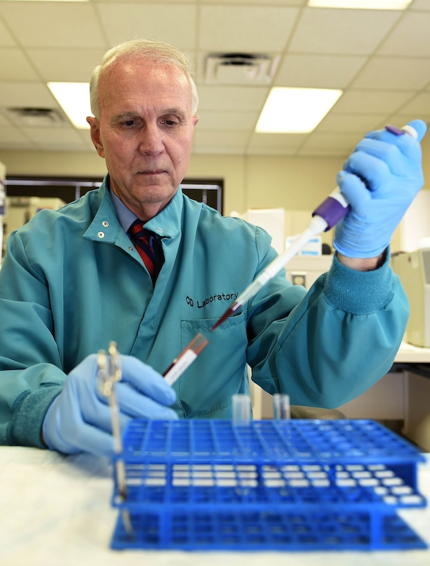 Clinical research scientist David McGlasson pipets a blood sample for analysis Aug. 18, 2015 at the 59th Medical Wing's Clinical Research Division facility on Joint Base San Antonio-Lackland, Texas. McGlasson recently received the American Society for Clinical Laboratory Science's Scientific Researcher of the Year Award for 2015, his eighth win since 2002. (U.S. Air Force photo/Staff Sgt. Jerilyn Quintanilla)