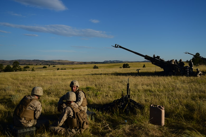 Marines from Quebec Battery, 5th Battalion 14 Marines, wait for a fire mission Aug. 15, 2015, in Guernsey, Wyoming. Q Battery, a Marine reserve artillery battery, conducted a live-fire exercise for four days to gain proficiency in their craft. (U.S. Air Force photo by Airman 1st Class Luke W. Nowakowski/Released)