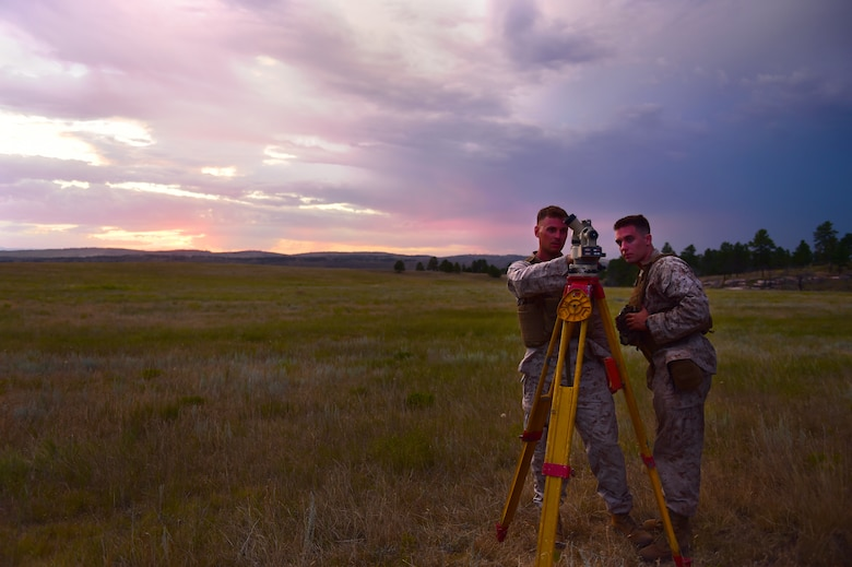 Sgt. John Frost and Lance Cpl. Joshua Weemes, Quebec Battery, 5th Battalion 14 Marines fire direction center, conduct measurements Aug. 14, 2015, in Guernsey, Wyoming. These Marines use meteorological equipment to collect data that will be used in the calculations that determine the angles of an artillery gun before firing. (U.S. Air Force photo by Airman 1st Class Luke W. Nowakowski/Released)