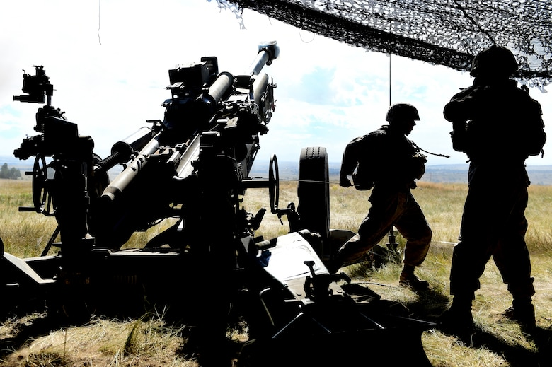 Lance Cpl. Nathaniel Cintron, 5th Battalion 14 Marines cannoneer, pulls a lanyard to activate the firing mechanism in the M777 A2 Howitzer Aug. 15, 2015, in Guernsey, Wyoming. As the number one man on the gun, his job is to fire the M777 A2 Howitzer when given the command 'fire' by the gun chief. (U.S. Air Force photo by Airman 1st Class Luke W. Nowakowski/Released)