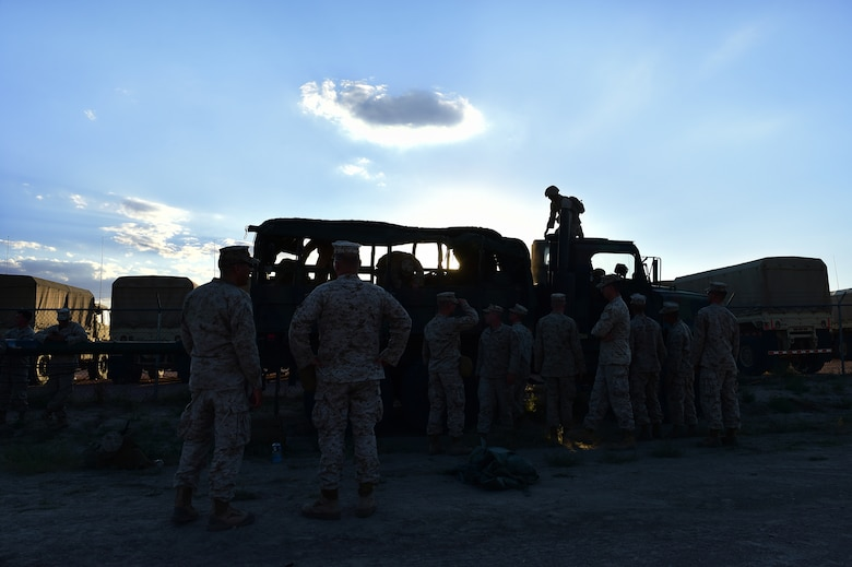 Marines from Quebec Battery, 5th Battalion 14 Marines, unload equipment Aug. 13, 2015, at Camp Guernsey, Wyoming. Quebec Battery Marines, a reserve unit that stage out of Buckley AFB, readied equipment the night before they hit the countryside for a three-day live fire exercise. The unit completes live fire exercises during the year to stay proficient at their craft. (U.S. Air Force photo by Airman 1st Class Luke W. Nowakowski/Released)
