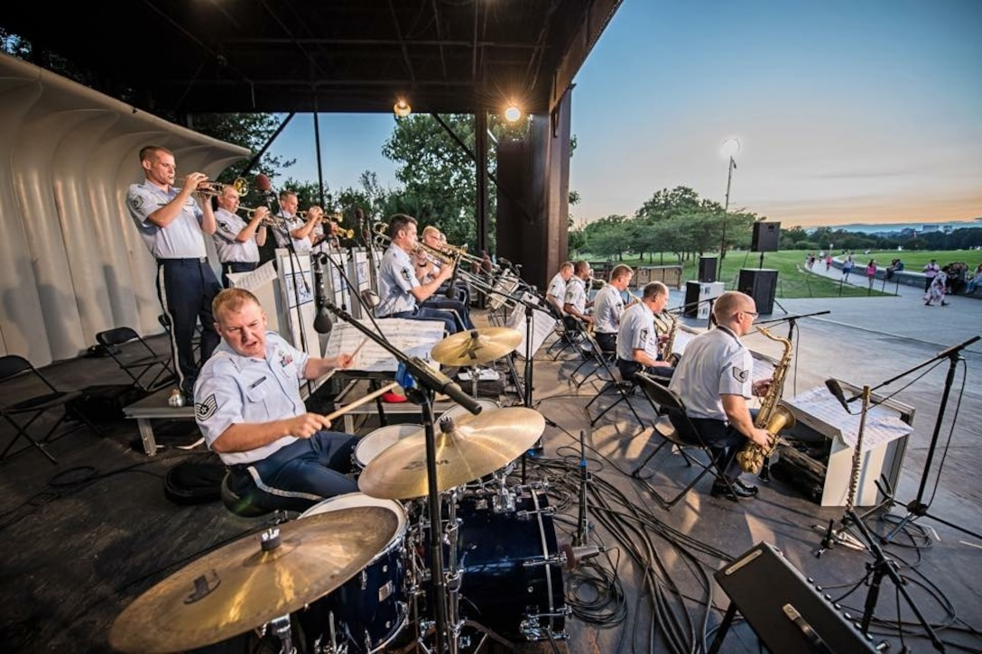 Technical Sergeant David McDonald, drum set, leads the Airmen of Note in their concert at the Sylvan Theater at the base of the Washington Monument in D.C. (U.S. Air Force Photo by Senior Master Sgt. Kevin Burns/released)