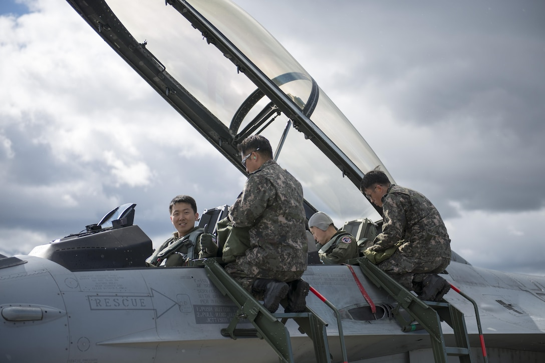 Republic of Korea Air Force (ROKAF) Majs. Lee Jong Won and Lee Dong Seop, both ROKAF F-16D Fighting Falcon pilots, ensure their equipment is secured prior to the launch of a RED FLAG-Alaska (RF-A) 15-3 sortie, Aug. 11, 2015 from Eielson Air Force Base, Alaska. Units from across the Department of Defense and allied forces have utilized the Joint Pacific Alaska Range Complex's 67,000 square miles of airspace for RED FLAG-Alaska since 2006 because it is the largest instrumented air, ground and electronic combat training range in the world. (U.S. Air Force photo by 1st Lt. Elias Zani/Released)