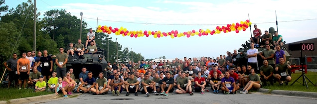 Marines from 2nd Radio Battalion gather for a photo before a memorial run in honor of Sgt. Lucas Pyeatt aboard Camp Lejeune, N.C., Aug. 1, 2015. The annual run has been hosted by the battalion for three years and commemorates Pyeatt and other fallen service members.  (U.S. Marine Corps photo by Pfc. Erick Galera/Released)