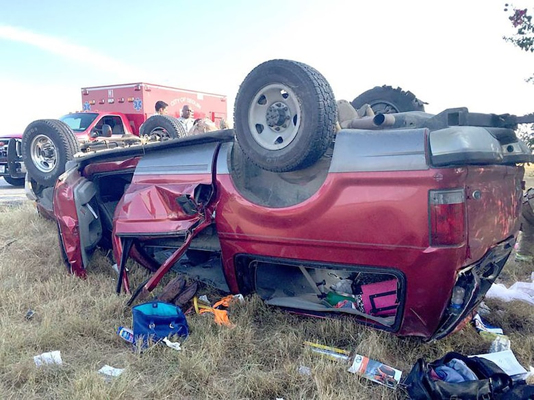 An overturned Ford Excursion rests in the median after rolling over, seriously injuring all six passengers on August 16, 2015 near Interstate 10 East. Four 433rd Airlift Wing Airmen stopped and provided immediate care to the injured passengers until first responders arrived on scene. (Courtesy photo/Seguin Gazette)