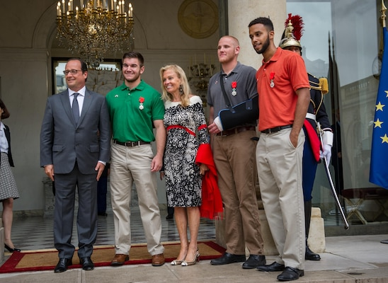 Spc. Alek Skarlatos, green shirt, with the Oregon Army National Guard's 41st Infantry Brigade Combat Team, stands with French President François Hollande, left, Jane Hartley, U.S. ambassador to France, and friends Air Force Airman 1st Class Spencer Stone, with cast, and Anthony Sadler after a ceremony Monday at the Élysée in Paris where they received the Legion of Honor, France's highest award, for their actions in subduing an attacker on a Paris-bound train armed with an assault rifle and other weapons. The three friends, with the help of a British passenger, tackled and subdued the gunman when he stopped to reload after opening fire in an adjacent car. (U.S. Air Force photo/Tech. Sgt. Ryan Crane)