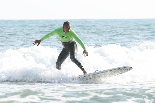 Master Sergeant Hugo L. Gonzalez surfs with Operation Amped at San Onofre Beach, August 21. Operation Amped is an annual weekend surfing event open to Wounded Warriors and their families. Operation Amped's mission is to share the surfing community and the healing potential of surfing with seriously ill, injured, or disabled U.S. military veterans and their families.