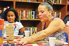 Rose Moody, wife of Chief Warrant Officer 2 Damien Moody, 1st Sustainment Brigade, 1st Infantry Division, pulls a Jenga tile from the stack during USO Fort Riley Unplugged: Family Game Night August 14 at the USO Fort Riley building.